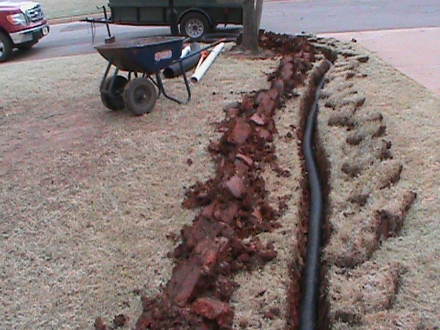 French Drain Pipe running to curb outlet in Oklahoma City.