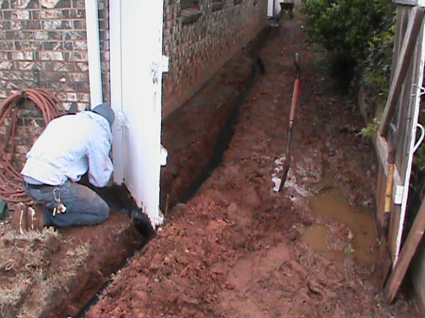 Installing French Drain along foundation of home in Norman
