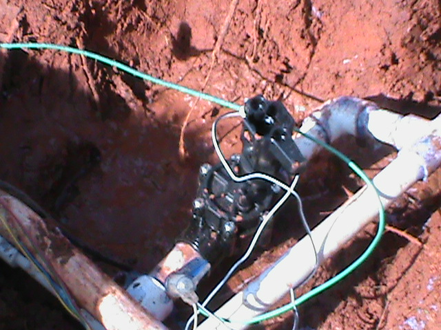 Changing out a broken sprinkler valve in Edmond Oklahoma