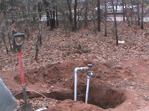 Installing a Sprinkler Back-Flow Valve in the woods in East Norman
