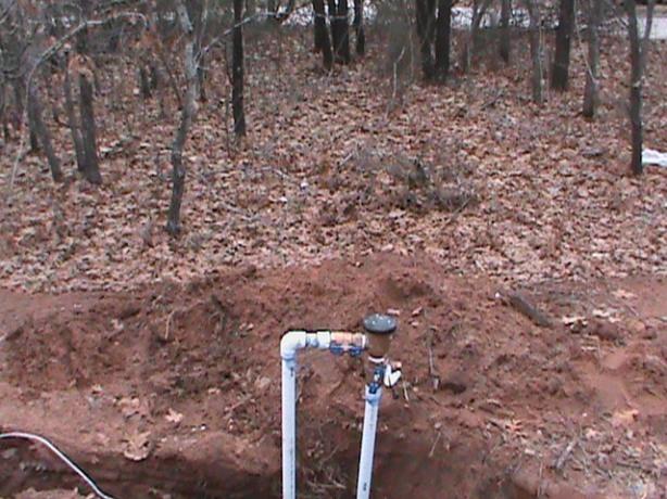 Installing a back-flow-valve in east Norman.