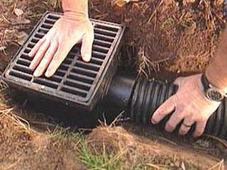 12 inch Drain Basin with a black grate connected to 4 inch Drain Pipe