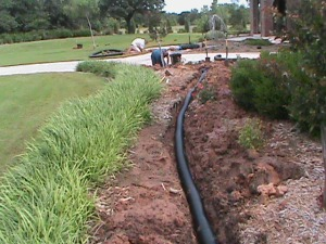 4 Inch Drain Pipe Ready to be covered with dirt in Norman.
