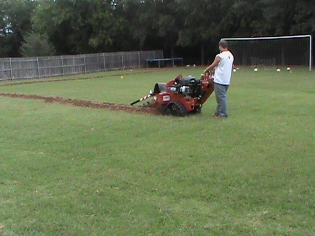 Trenching a Sprinkler System in Moore.