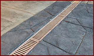 A channel drain is one of many types of Surface Drains.