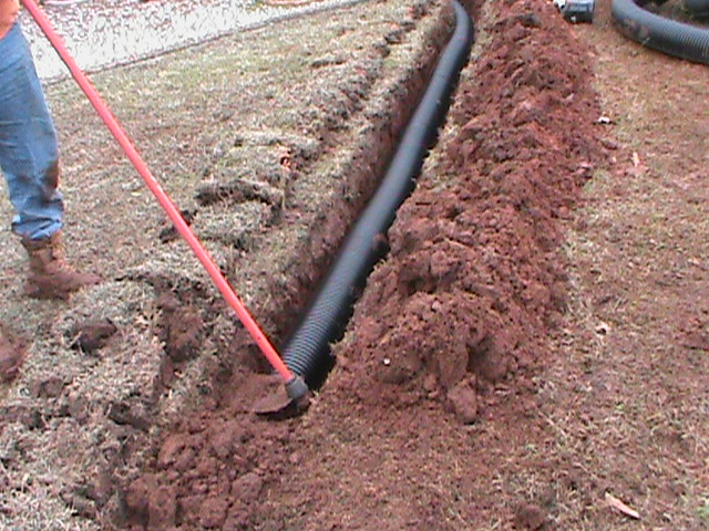 Running Drain Pipe across Front Yard for a French Drain