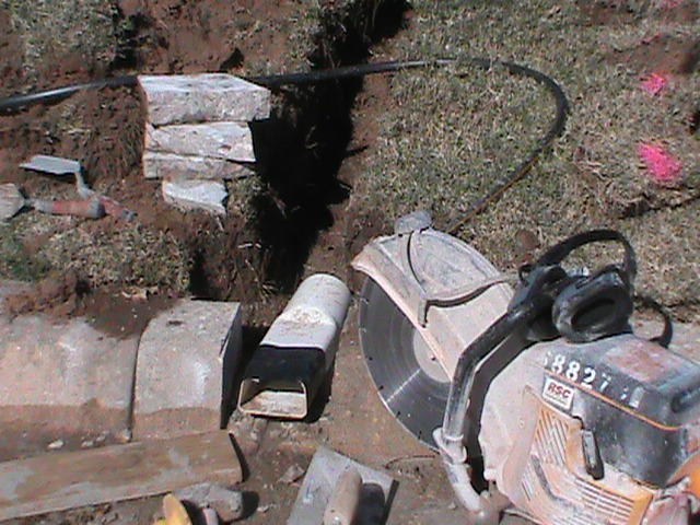 Cutting The Curb and Installing Curb Fitting for French Drain
