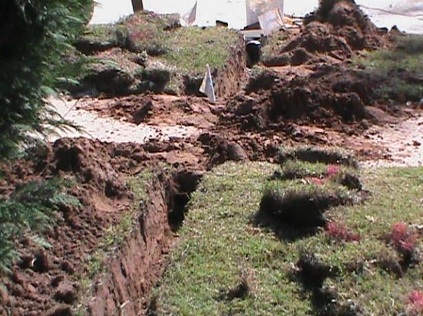 Digging French Drain Trench under Sidewalk