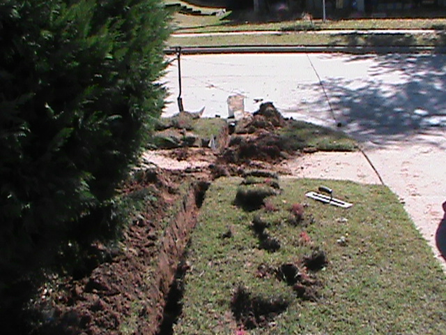 French Drain Trench Going Under Sidewalk