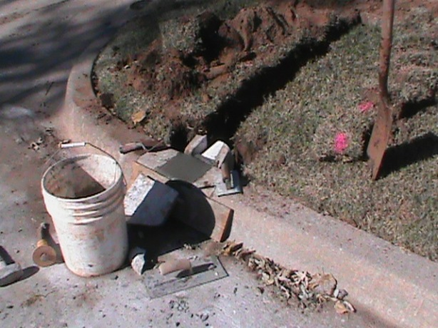 Installing a Curb Outlet for a French Drain