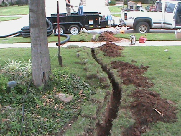 Trench leading to street from French Drain in Back yard in Edmond