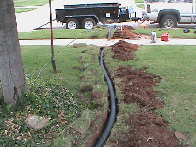 French drain installed in oklahoma city central for Garden drainage system