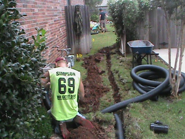 Running solid Drain Pipe From French Drain in Back Yard to Curb