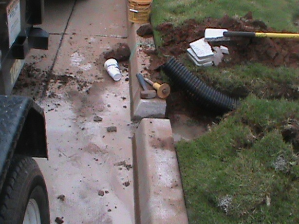 Installing Curb Outlet for French Drain in Oklahoma City