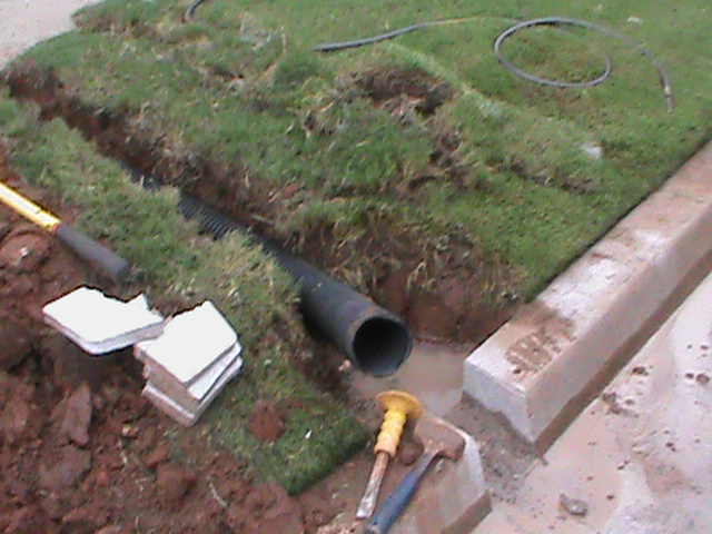 Curb Outlet for French Drain in Edmond Oklahoma