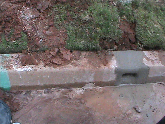 Curb Outlet to release water from French Drain in Norman