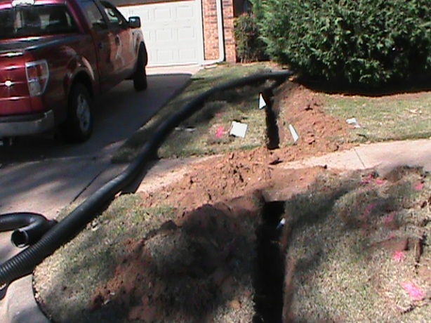 Installing French Drain Pipe