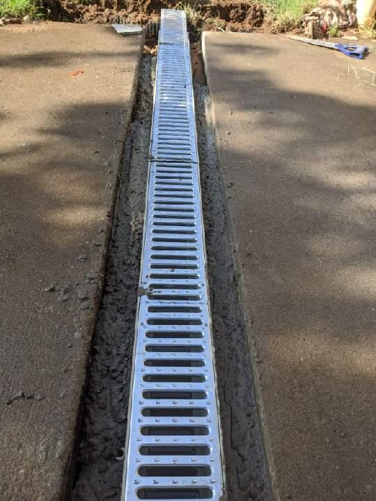 Installing concrete around drain