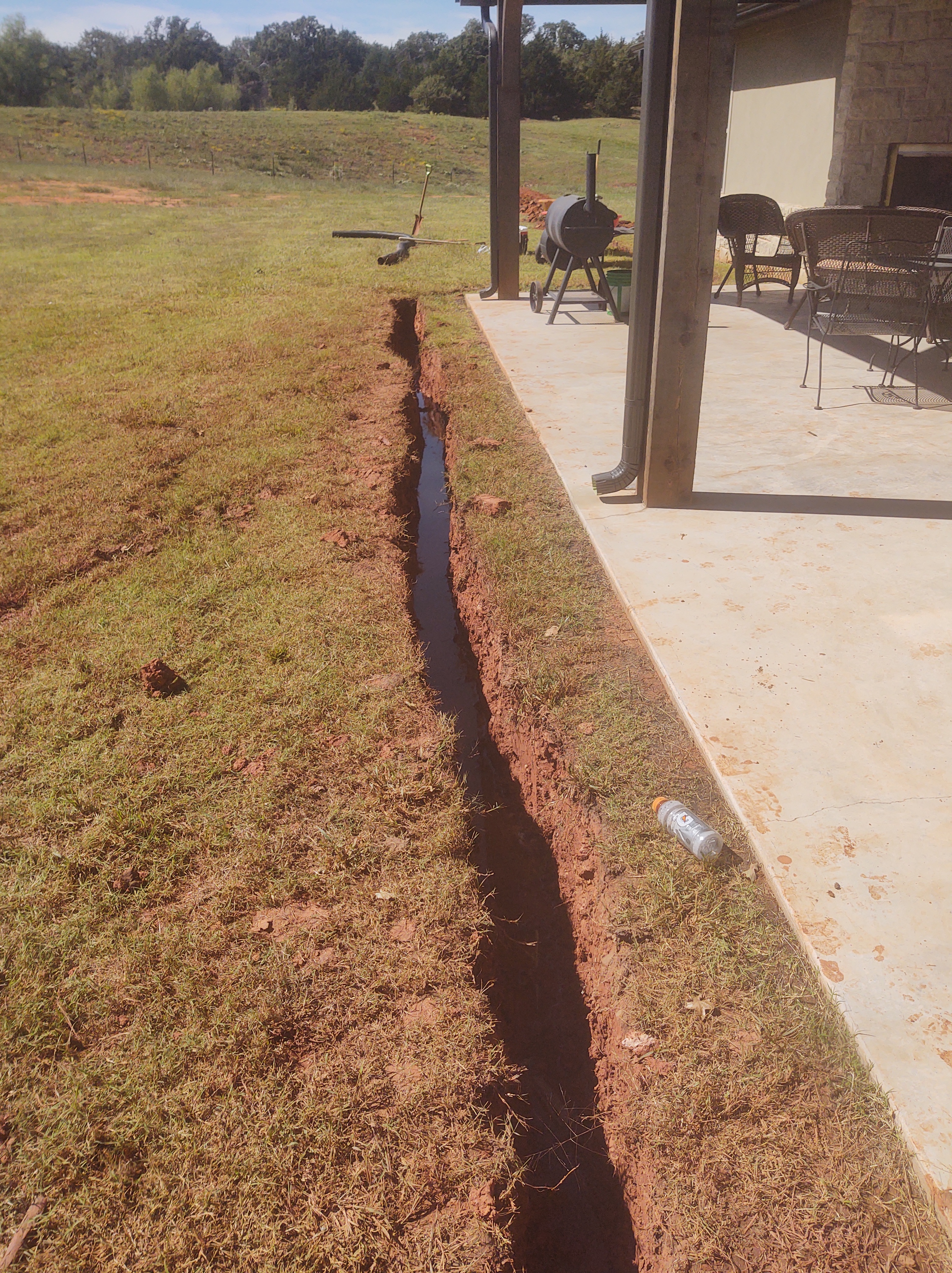 french drain pipe in trench
